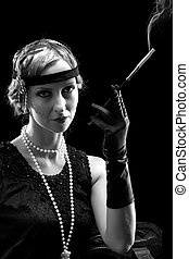 Smoking in vintage style - Woman in flapper dress in...