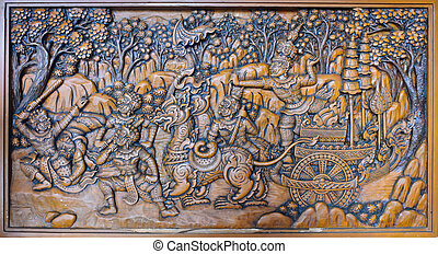 The ramayana epic wood carved on temple wall, Thailand