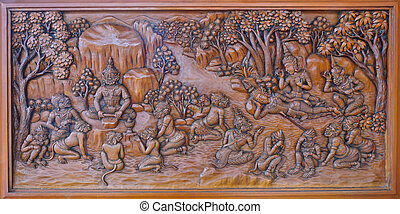 Wood carving of ramayana epic on temple wall, Thailand