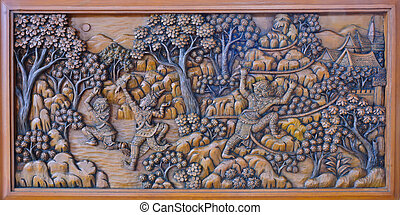Ancient wood carving of ramayana epic on temple wall,...