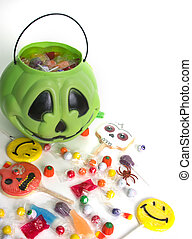 Halloween Candy - Green pumpkin halloween bucket filled with...