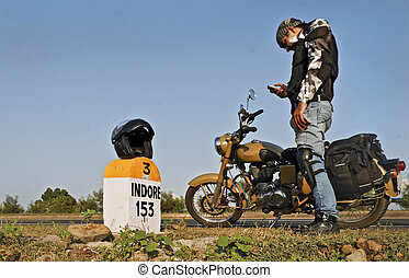 Biker texting sms using mobile phone - Motorcyclist stopped...