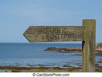 Wooden Sign Post  By The Sea