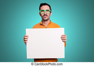 man holding blank white board - man with orange sweater...
