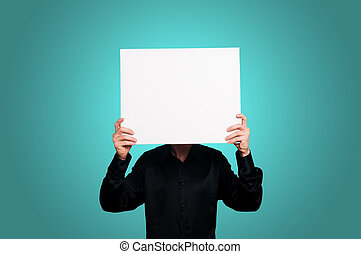 man holding blank white board