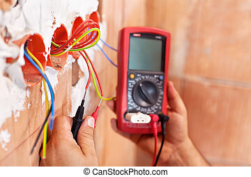 Electrician working - closeup on hands