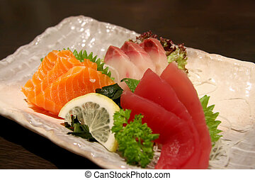 Plate of sashimi - Arrangement of sashimi sliced raw...