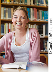 Student sitting at library desk
