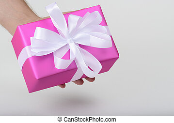 gift in purple paper - gift with white ribbon in purple...