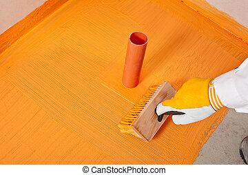 plumber builder brush applied waterproofing pipe corner...