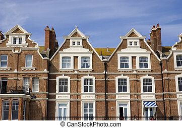 Townhouses - A row of victorian townhouses with a blue sky