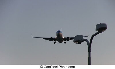 Airplane flying overhead at dusk - This is high quality HD...