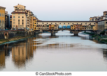 Ponte Vecchio Bridge Across Arno River in Florence at...