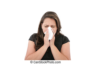 A woman with a cold or allergy wiping or blowing her nose.