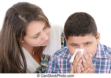 Child blowing nose. Child with tissue. catarrh or allergy