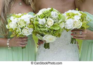 bridesmaids in green with wedding bouquet - bridesmaids...
