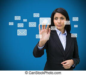 Concentrate businesswoman touching at a message symbol...