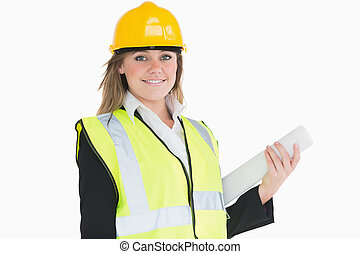 Female architect holding a plan and smiling