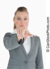 Businesswoman pointing on something