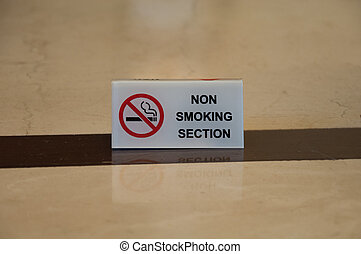 non smoking section sign on table