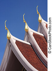 Gable apex on the roof of royal temple in Rayong, thailand.