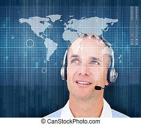 Man smiling wearing a headset - Man smiling while wearing a...