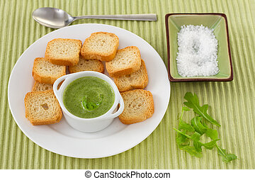 green sauce with toasts on the plate