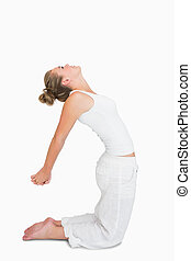 Woman in camel yoga pose