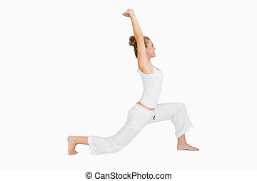 Woman in low lunge yoga pose - Woman stretching in low lunge...
