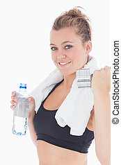Woman holding weights and a bottle of water