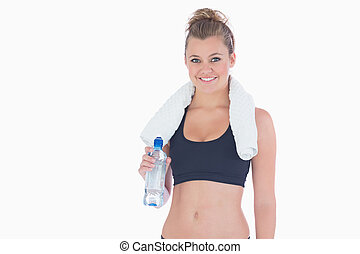 Woman smiling while holding a bottle of water