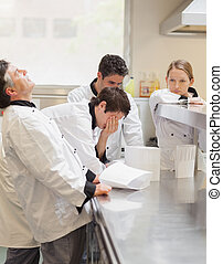 Frustrated, Chef's, discussing, menu