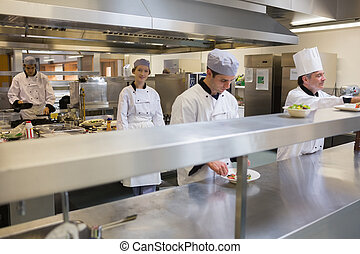 Restaurant kitchen with Chefs cooking - Restaurant kitchen...