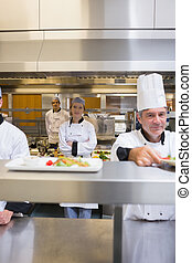 Busy restaurant kitchen with Chef's