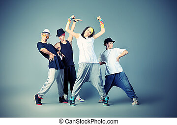 hip hop - Group of modern dancers dancing hip-hop at studio
