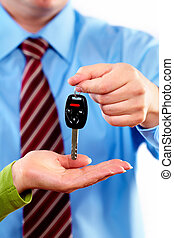 Hand with a car key. Isolated on white background.