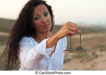 Peaceful scene - Hispanic woman in a peaceful spiritual...