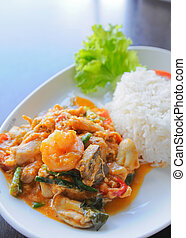 Thai food. rice and shrimp with sweet and spicy sauce, stir...