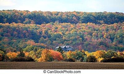 Mansion on the Escarpment amongst autumn colours