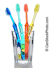 Four Toothbrushes in Glass - Four multi-colored-toothbrushes...