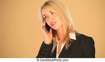 Blonde businesswoman on a smartphon