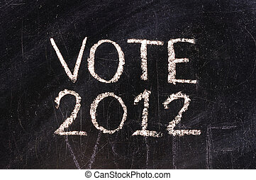 Vote written on blackboard in chalk and underlined.