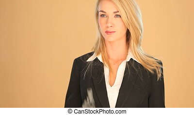 Blonde businesswoman with a gun