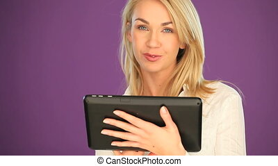Happy blonde student working tablet - Head and shoulders...