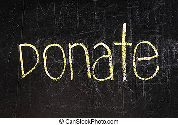 Donate written on blackboard in chalk and underlined.
