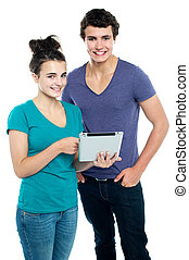 Technology savvy couple browsing newly launched tablet in...
