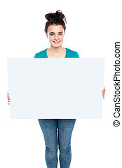 Adorable smiling teenager holding big ad board Isolated on...