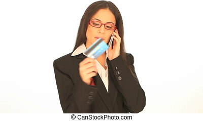 Businesswoman doing telephone banki - Attractive brunette...