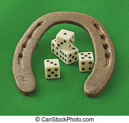 Horseshoe with dice - An horseshoe over green background...