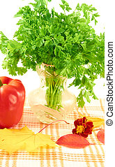 Autumn still life - A bunch of parsley in vaze, red pepper,...